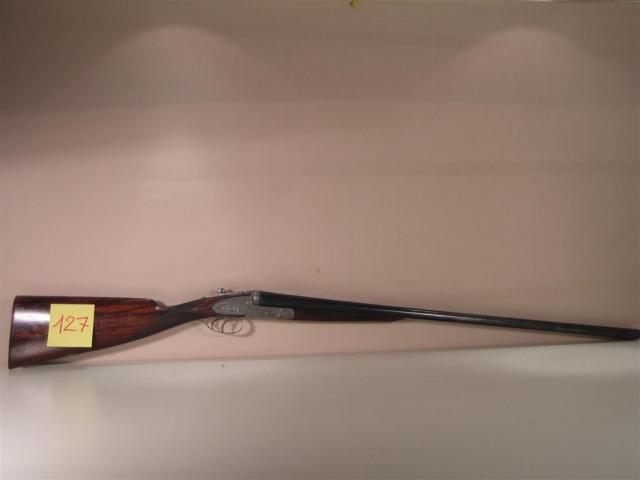 28c006c223a Fusil de chasse juxtaposé à platine de marque   Holland Holland.